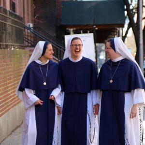 Sisters walking in city